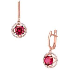 Aretes de oro rosa con rubí